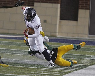 .          ROBERT  K. YOSAY | THE VINDICATOR..Fitchs #18  Antwan Harris is brought down by St Eds #1  David Dowell after short yards during third quarter action ..Austintown Fitch and St Edwards at Infocision in Akron.....-30-