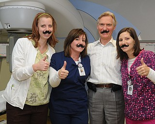 Charleen Howell, left, Sheri Pluchinsky, Dr. Eric Svenson and Becky Marlatt of Partners for Urology Health in Austintown recently sported fake mustaches but thumbs-up for the Movember cause.