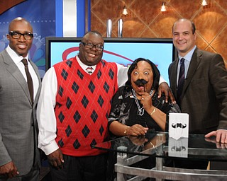 Deryck Toles, left, a former NFL player and founder of Inspiring Minds in Warren, Rev. Lewis Macklin, Madonna Chism Pinkard and Dr. Dan Ricchiuti took a pre-Movember photo on the set of WFMJ's Community Connection.
