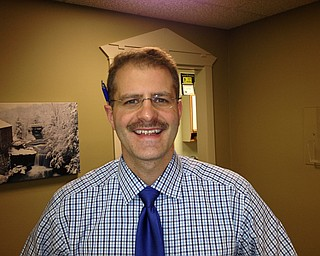 Dr. Mark Memo D.O., a urologist and surgeon, displayed his mid-Movember facial hair.