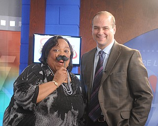 Madonna Chism Pinkard, host of Community Connection on WFMJ, joined in on Movember fun with Dr. Dan Ricchiuti.