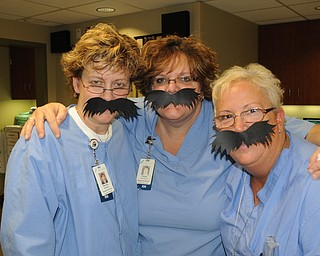 Michelle McBride, left, Emilie Doneyko and Debbie Ferrell, nurses in same-day surgery at St. Elizabeth Hospital, showed their support for Movember.