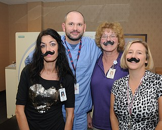 Supporters of Movember from the  oncology department staff at St. Elizabeth Hospital wore fake mustaches for the cause.