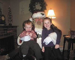 """Pictured are Dallas and Laila Mortimer, both of Hubbard, with Santa. Picture sent by their """"Meme"""" (grandmother), Patty Ball."""