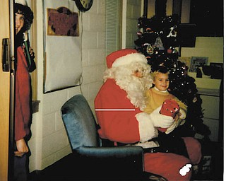 This is Adam Fill on Santa's lap when he was about 2 years old. He loved his ninja turtles. He is currently a teacher for Lisbon School District.