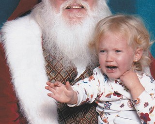 Mena Monroe, 3, was not a happy girl when it was her time to meet Santa. She is the granddaughter of Russ and Ellen Monroe of Austintown.