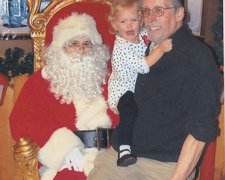 Even a little help from Grandpa Russ didn't convince Mena Monroe, 3, that there was nothing to be afraid of.