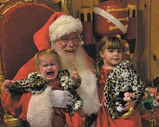 Bev Craig of Salem took this picture at the annual visit to see Santa. Her granddaughter Bianca, 3, was excited about the visit. Her sister Marissa,1, just wanted to go back home to Wooster. Santa loved it.