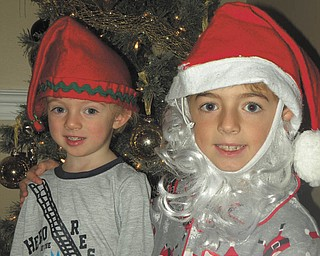 Big brother Anthony Triveri, 7, has been trying really hard this season to get his little brother Kyle, 2, to sit on Santa's lap with him by dressing up like Santa and acting the part. Kyle is skeptical, but Anthony is determined to get a picture with him somehow. Submitted by their mom, Kim Triveri.