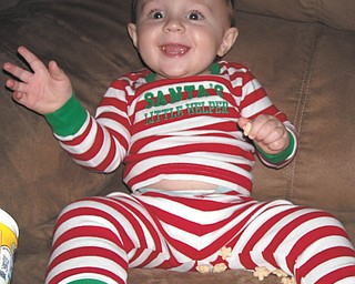 """One-year-old James Pellegrini hasn't visited Santa yet, but his parents, Eric and Lisa Pellegrini of Austintown, wanted to share this picture of him with his """"Santa's Little Helper"""" jammies on!"""