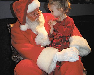 """Sarah Hoefert sent her favorite photo of her daughter Jaime with Santa. She took the photo in 2010 at the Youngstown Playhouse, where they had gone to have lunch with Cinderella. Jaime, who was 3 at the time, was so thrilled when Santa made a surprise visit that she climbed right up on his lap and whispered, """"I've reeeally been gooood this year, Santa."""""""
