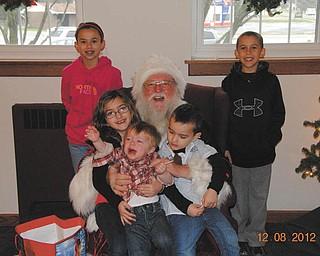 Angela Santangelo-Jones sent this photo of Caden Jones (front) and Mariah and Dominick Jones on Santa's lap and Morgan and Mason Santangelo standing.