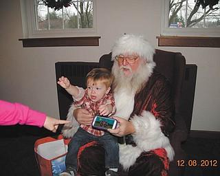 Caden Jones is expressing his true feelings during his first experience with Santa. Photo sent by Angela Santangelo-Jones.