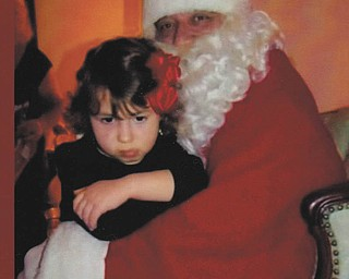 Gianna Dutton was upset because Santa was giving little gifts to the children. Gianna's sister Alayna sat on Santa's lap first, so she thought there were no more gifts for her. Her parents are Jeff and Becky Dutton and grandparents are Ellie Dutton and Lou and Nancy Schepka. All live in Poland.