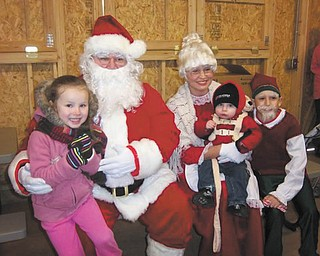 Pictured are Laila Mortimer on Santa's lap, Dallas Mortimer on Mrs. Claus' lap, both of Hubbard, and one of Santa's elves! Picture was sent by Patty Ball of Hubbard.