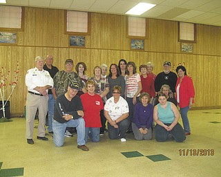 SPECIAL TO THE VINDICATOR Above, American Legion Post 737 volunteers prepared for the Veterans of Wade Park to arrive Nov. 13 for a meal, karaoke and dancing. Kneeling, from left are John Chittock, Joyce Street, Kathy Rutushin, Mary Ann Leonard, Elizabeth Ahart and Kathy Bittinger; and standing are Jim Boehmer, commander; Dave Hahlen; Gary Davis; Stacey Carritz; Eileen Carritz; Faye Hunberston; Marie Hoppel; Holly Barr; Phyllis Nuzzie; Linda Glunt; Donna Loomis; Bud Bittinger; and Jodi Minotti.
