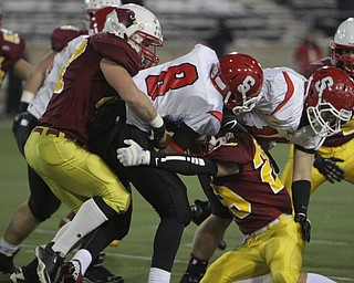 Nick Hubert (47) and Joe Kleeh (29) of the Cardinal Mooney defense bring down Steubenville quarterback Mandela Lawrence-Burke (8) during the first quarter of Friday nights Division four Semi-Finals matchup at Fawcett Stadium in Canton.  Dustin Livesay     The Vindicator  11/29/13  Fawcett Stadium, Canton.