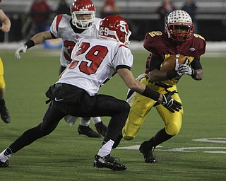 Cardinal Mooney's C.J. Amill (2) attempts to juke around Steubenville's Niko Petrides (29) during the second half of Friday nights Division four Semi-Finals matchup at Fawcett Stadium in Canton. Amill rushed 17 times for 82 yards and a touchdown in Mooney's 37-7 victory over the Big Red.  Dustin Livesay  |  The Vindicator  11/29/30  Fawcett Stadium, Canton Ohio.