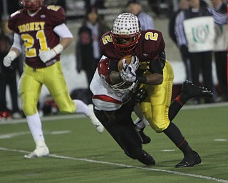 Cardinal Mooney's C.J. Amill (2) picks up a few tough yards while being dragged down by Steubenville's Arin Goldsmith (42) during the second half of Friday nights Division four Semi-Finals matchup at Fawcett Stadium in Canton. Amill rushed 17 times for 82 yards and a touchdown in Mooney's 37-7 victory over the Big Red.  Dustin Livesay  |  The Vindicator  11/29/30  Fawcett Stadium, Canton Ohio.