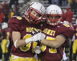Cardinal Mooney seniors Ryan Megyesi (86,left) and Dom Divencenzo (67) celebrate after time expired during the Division four Semi-Finals matchup against Steubenville at Fawcett Stadium in Canton on Friday night.  The Cardinals beat Steubenville37-7 and advance to the State Championship game against Clarksville Clinton-Massie.  Dustin Livesay     The Vindicator  11/29/30  Fawcett Stadium, Canton Ohio.