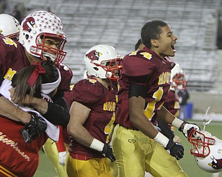 Cardinal Mooney senior Desmond Ford (14) jumps in the air celebrating after the division four Semi-Finals matchup against Steubenville at Fawcett Stadium in Canton on Friday night.  The Cardinals beat Steubenville37-7 and advance to the State Championship game against Clarksville Clinton-Massie.  Dustin Livesay  |  The Vindicator  11/29/30  Fawcett Stadium, Canton Ohio.