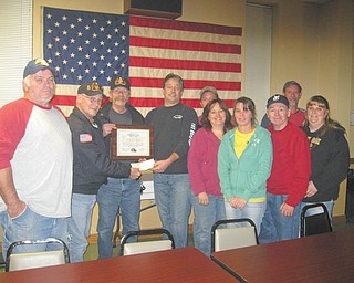 SPECIAL TO THE VINDICATOR Lake Post 737 Legion Riders visited Jefferson Eagles Aerie 3881 Nov. 14 to accept a donation of $525 for the American Legion Legacy Scholarship Fund. A plaque was presented for their donation. The Riders have collected over $6,433 this year and total contributions since 2007 are $30,430. The scholarship fund provides aid for children who lost a parent since Sept. 11, 2001, in service to our country. Above, from left, are Brian Hall, Jefferson Eagles Aerie 3881, president; John Chittock, American Legion Rider Post 737 chaplain; Rick Cadle, American Legion director; and Tom O'Mears, Jefferson Eagles trustee. On the far right is Bud Bittinger, American Legion Rider road captain. The rest are members of Jefferson Eagles Aerie.