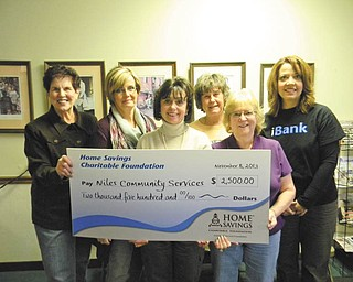 SPECIAL TO THE VINDICATOR Home Savings Charitable Foundation recently donated $2,500 to Niles Community Services to support its program of providing for those in need in the Niles area. For information on Niles Community Services call 330-652-6412. Above from left are Jean Williams, executive director of Niles Community Services; Lori Antonelli, Jackie Bell, Anna Mae Cushna and Shirley George, volunteers for NCS; and Trish Mohan, branch manager for Home Savings main office.