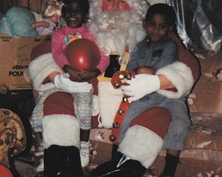 Santa visited twins Michelle and Michael Pete, 5, at their home. Sent by mom, Othella May.