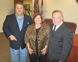 Trumbull County commissioners Dan Polivka, left, and Frank Fuda, right, along with commissioners' clerk Paulette Godfrey are among 30 county employees taking part in the 16-week Lose and Win program in which they will exercise and receive counseling on nutrition.
