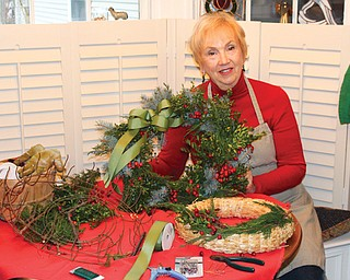 OSU Extension Master Gardener Volunteer Barb Delisio shows some of the supplies needed to use fresh greenery in the home.