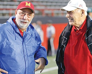 Don Bucci, right, is one of just four head coaches in Cardinal Mooney football history. Bucci took over in 1966 and spent 34 seasons leading the Cardinals. He guided Cardinal Mooney to four state championships before retiring from coaching and taking over as athletic director. Bucci is pictured with former Cardinals basketball coach Roy Nard.