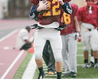 Cardinal Mooney's Mark Handel runs through drills during a practice at The WATTS at Youngstown State University. The Cardinals face Clarksville Clinton-Massie today in Massillon for the Division IV state title.