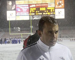 William D Lewis The Vindicator Mooney coach  PJ Fecko walks off the field after loosing state chapionship 27-21 in Massilon Dec 6, 2013.
