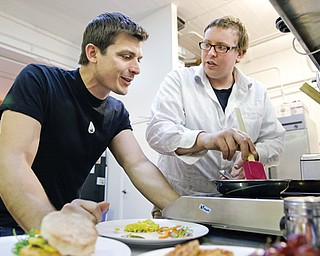 CEO Josh Tetrick, left, watches as research and development chef Trevor Niekowal makes a plant-based scrambled egg at Hampton Creek Foods in San Francisco. Can plants replace eggs? A San Francisco startup backed by Bill Gates believes they can. Hampton Creek Foods is scouring the planet for plants that can replace chicken eggs in everything from cookies to omelets to French toast.