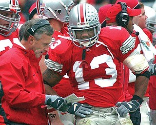 """Ohio State coach Jim Tressel talks with freshman tailback Maurice Clarett in this game from 2002. Their departures from Ohio State will be documented in ESPN's film """"Youngstown Boys"""" that will be televised on Saturday."""
