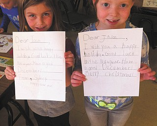 SPECIAL TO THE VINDICATOR Students in Heidi Cope's first-grade class at Seaborn Elementary School in the Weathersfield School District have been writing letters to our troops for Operation Holiday Cheer. Letter writers from left are Sydney Wyllie and Maggie Collins.