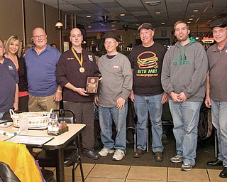 From left to right, are John Spatar, Lisa Neeld-Infante, Bob DeVicchio, Mel McKee, Anthony Fuda, Scott Long, Eric Tranovich and Jerry Tranovich at Bogey's Bar and Grill in Lowellville.