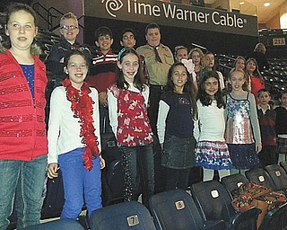 The Holy Family Youth Choir recently sang at a Phantoms hockey game at the Covelli Center. The choir sang the National Anthem and service songs in honor of Veterans Day. For information on how to join, contact Barb Zorn at zornbarb@aol.com. 