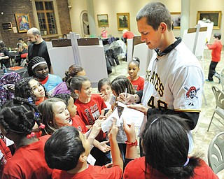 Pirates pitcher Jared Hughes signs autographs for Campbell fourth graders during the Pirates caravan Wednesday night at the Butler Institute of American Art in Youngstown.