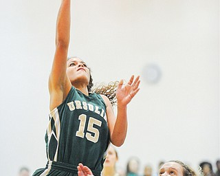 Ursuline's Macey Gunther puts up a shot under the basket as Harding's Chelsea Dipaolo defends during Wednesday's game at Warren Harding. Ursuline won 52-40.