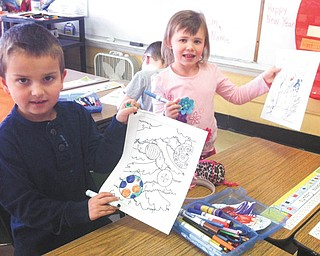 SPECIAL TO THE VINDICATOR Students in the first grade at Seaborn Elementary School in the Weathersfield School District have been preparing letters and pictures to send to our troops for Operation Holiday Cheer. Their teacher is Heidi Cope. Artists are Ayden Rossi and Gianna Caputo.