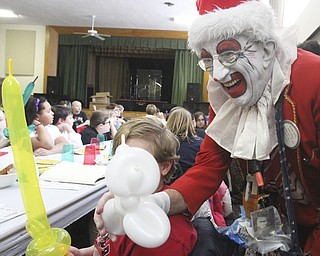 William D Lewis The Vindicator Aut Mori Grotto clown J.J. aka James Losasso, entertains children at StruthersRotary Christmas party 12-17-13 at Struthes Presbyterian Church.