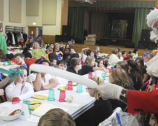 William D Lewis The Vindicator Aut Mori Grotto clown J.J. aka James Losasso, entertains children at StruthersRotary Christmas party 12-17-13 at Struthers Presbyterian Church.