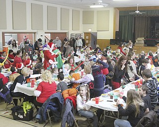 William D Lewis The Vindicator More than 200 students from MAhoning County attended the Struthers Rotary Christmas party 12-17-13 at Struthes Presbyterian Church.