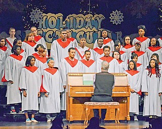 The choir at the Chaney Visual and Performing Arts School sings during dress rehearsal for the Holiday Spectacular public performance today at 6 p.m. Tickets are $4 for adults and $3 for students and are available at the door. The choir and other VPA students also will perform at 12:30 p.m. today and Friday for the student body.