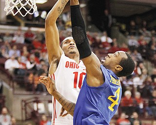 Ohio State's LaQuinton Ross tries to block a shot by Delaware's Jarvis Threatt during the first half of their game Wednesday in Columbus. The No. 3 Buckeyes bounced the Blue Hens, 76-64, behind Ross, who led OSU with 19 points.