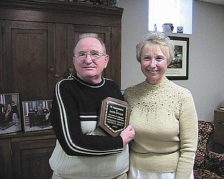 David Snyder, left, longtime member of the Springfield Township Historical Society, was presented with its 2013 Appreciation Award by Zonda Haase, president of the society. The award was presented at the annual dinner Dec. 8 at the home of Karry and Don Snyder Jr., a trustee of the society. SPECIAL TO THE VINDICATOR