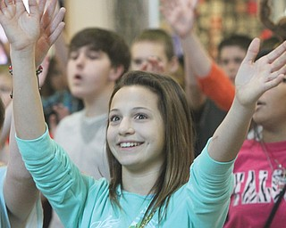 Austintown Middle School vocal music students perform at Southern Park Mall in Boardman. Among those singing and dancing Thursday was seventh-grader Kayla Kelty. The students performed four separate 15-minute holiday flash mobs to showcase their talent and spread the Christmas spirit.