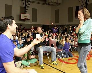 William D. Lewis The Vindicator Girard Intermediate School 5 th grade teacher Joe Carbon proposes to fellow 5th grade teacher Alyssa DiBernardi during a 12-20-13 asembly at the school.
