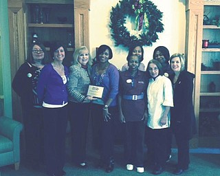 For the third year, Clare Bridge of Austintown was named top team for raising the most money in the Walk to End Alzheimer's. The team that won this year is named Brookdale Alz Starz, which raised more than $3,500, the largest amount by a corporate team. Helen Paes, community development coordinator for the Alzheimer's Association, and Theresa Depp, Family Service coordinator, presented a plaque. In front, from left, are Nickie Keagy, Heidi Polonus, Paes, Vanessa Montgomery, Darlene Ballard, Bernie Latosky and Andrea Capirano; in back are Sonya Bennett and Deborah Williams. SPECIAL TO THE VINDICATOR